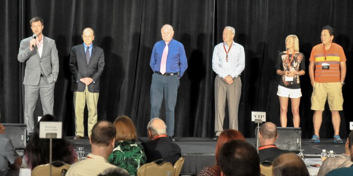 """Simon Black on stage at our """"Global Offshore & Investment Summit"""" in 2015 with Jim Rickards, Mark Faber, Peter Schiff, Kim Kiyosaki, and Robert Kiyosaki..."""