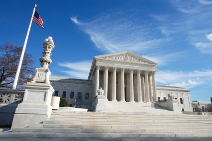 United States Supreme Court Building and American Flag